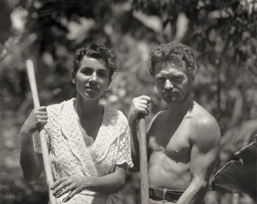 Dore Strauch and Friedrich Ritter holding tools in their garden at Friedo. Floreana Island, Galapagos. Circa 1932